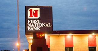 Exterior picture of First National Bank sign.
