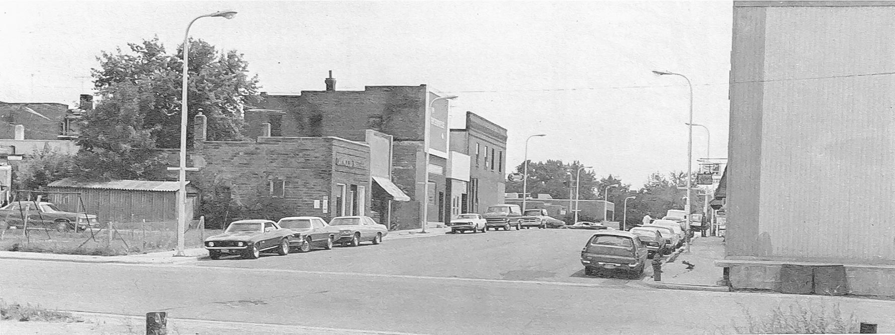 Picture of Millard Avenue looking south fro rail road tracks, 1976.